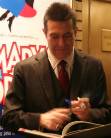 Lucifer signing autographs!